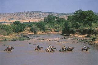 Riding Safaris  Crossing the river.jpg