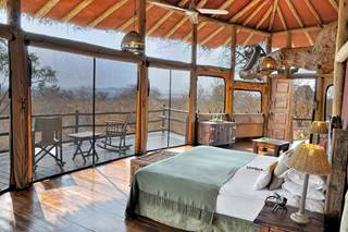 Tarangire Treetops - interior view of treehouse bedroom.jpg