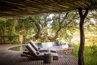 Singita Boulders Lodge - Suite Plunge Pool and Deck Chairs.jpg