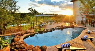 1. Signature Image Victoria Falls Safari Club - Pool.jpg