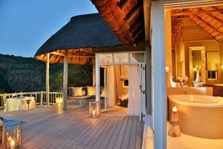 1. Signature Image Clifftop Exclusive Safari Hideaway - Suite Evening 1.jpg