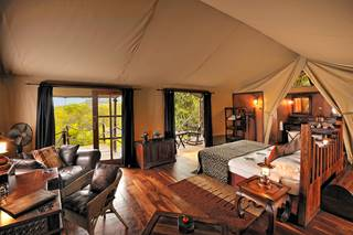 Serengeti Migration Camp - Interior of Main Tent and bathroom.jpg