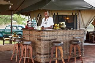 Singita Sabora Lodge Bar with Barman.jpg