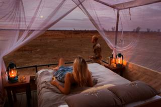Shenton Safaris' Mwamba 11 - Numbu Star Bed Moonrise.jpg