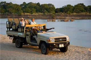 Game drive with elephant crossing.jpg