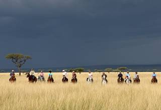 Riding Safaris leaving dark and stormy skies behind us.jpg