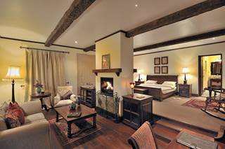The Manor at Ngorongoro - Interior Bedroom and Fire.jpg