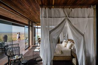 Hillside Suite, Singita Sasakwa Lodge - Bedroom and Deck.jpg