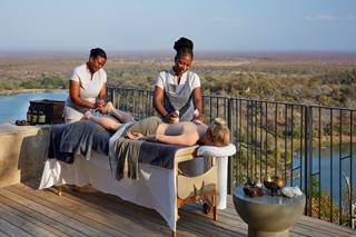 Singita Malilangwe House - Massage on deck.jpg