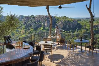 Singita Pamushana Lodge - Deck Overlooking Dam with waiter.jpg